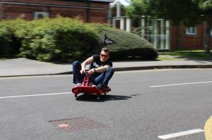 Me on a ridiculous kid scooter