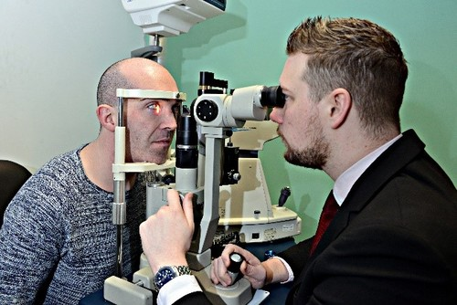 Gavin Paxton having his eyes tested at V