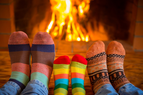 Big sock family near fireplace