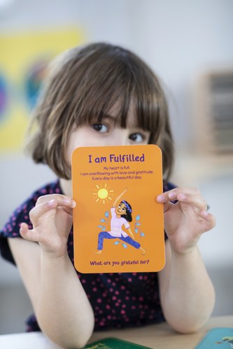 CHILD WITH I AM FULFILLED CARD