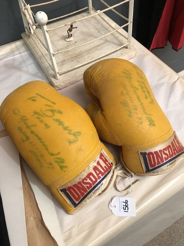 Lot 1566 - Muhammed Ali boxing gloves