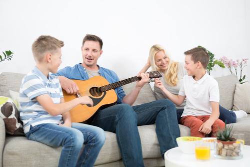 Family Fun playing a Yamaha F310 Guitar