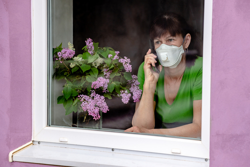 Lonely woman wearing face mask