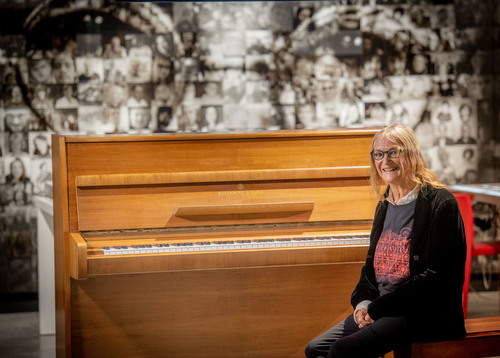 Lennon's sister Julia Baird with piano