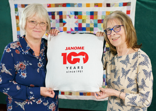 Picture of tutors with 100 anniv logo