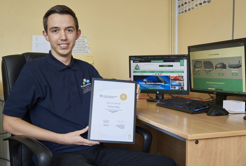 Tom with his NVQ Level 3 Certificate