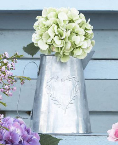 Metal jug with embossed laurel heart