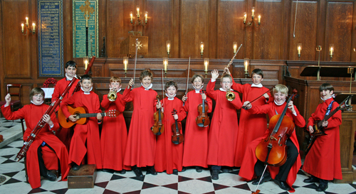 Choristers with an array of instruments