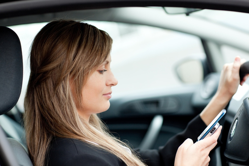 A woman texting and driving