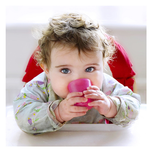 7 month old baby sipping from a Babycup