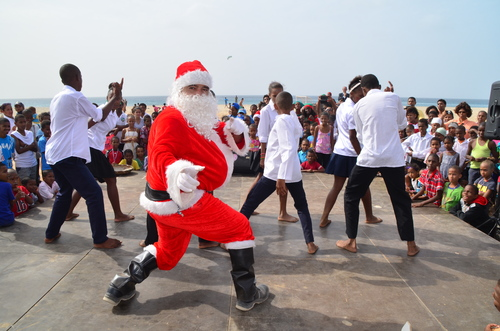 Santa dancing with show contestants