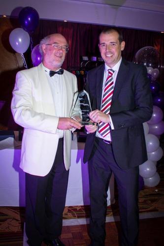 Bob Hughes Forton CEO presents award