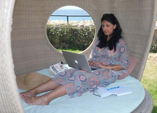Radha updating Facebook on holiday