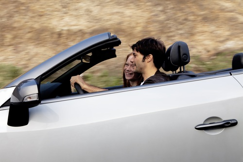 The 'perfect man' driving a convertible