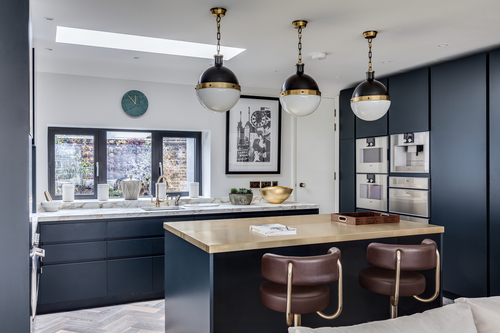 Blue kitchen with brass worktop
