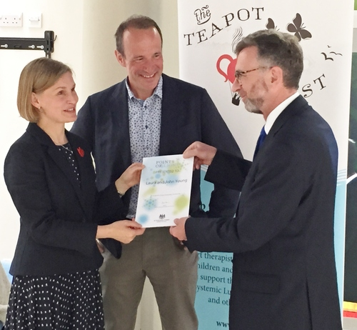 Laura and John receiving the award