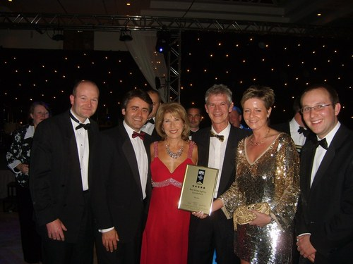 The team from Mundys receiving the award