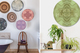 Eclectic hang of round acrylic prints