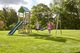 Swing, slide and climbing wall