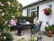 Mr & Mrs Pearson enjoying their garden